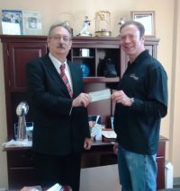 Ken Goldin (right), Founder of Goldin Auctions, presented a check for $5,000 to Joseph Blazejewski (left), Major Gift Officer of the American Red Cross South Jersey Region to assist with Hurricane Sandy relief efforts.